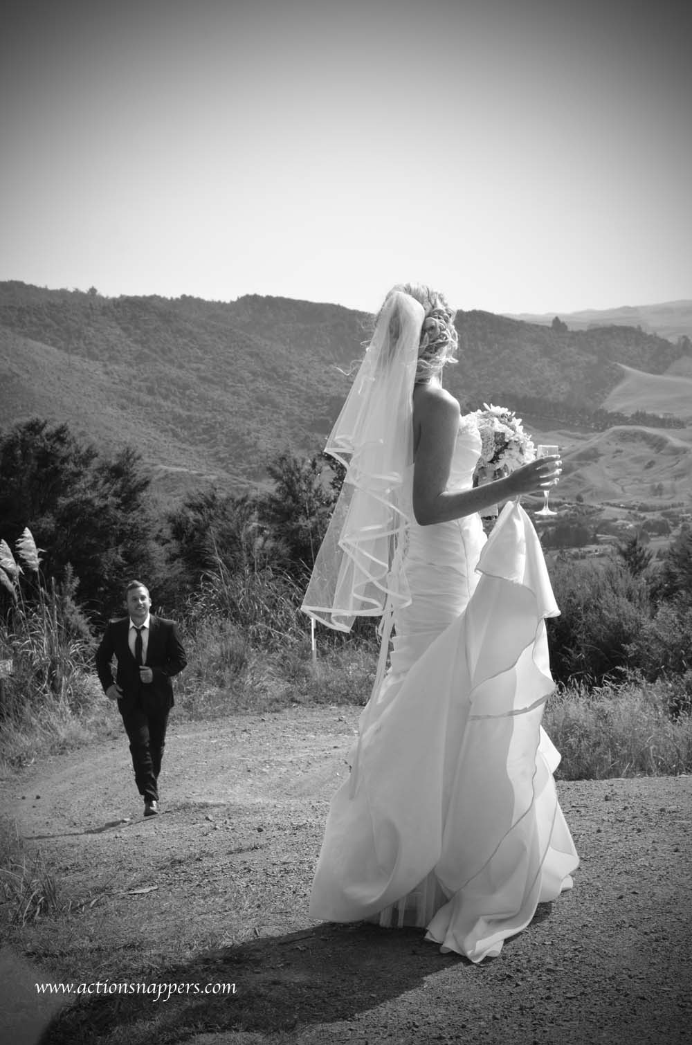 Groom chasing after bride by actionsnappers wedding photographer