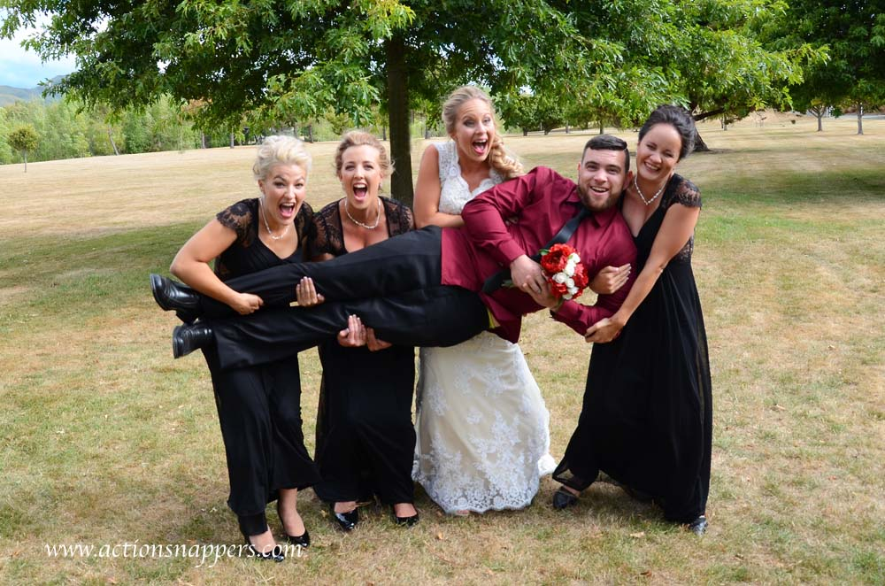 bride and bridesmaids carrying groom by actionsnappers  wedding photographer