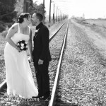 bride and groom kissing on the railway line near Windy Ridge wedding venue
