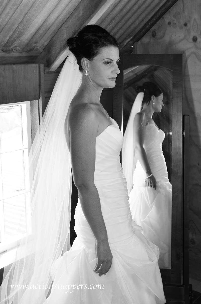 Bride at red barn