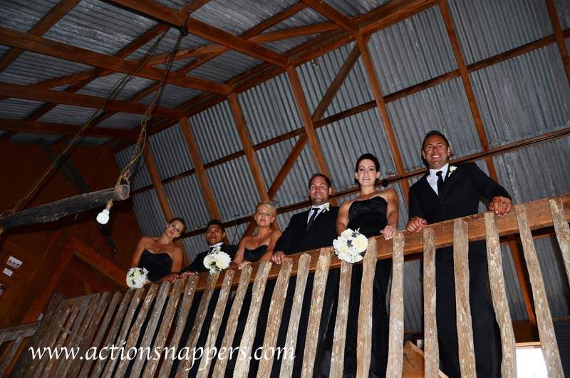 wedding photo of bridal party at red barn